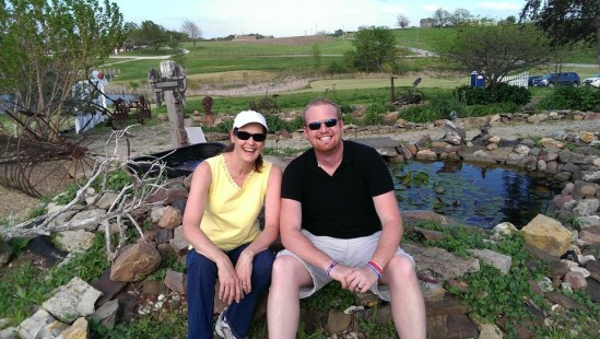MC and myself next to a pond and flowers on Mother's Day 2014.